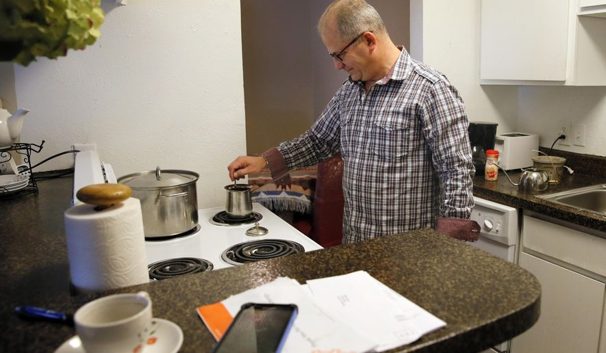 In this Nov. 25, 2015 photo, Nabil Kalo of Syria, prepares a pot of Turkish coffee in his apartment in Richardson, Texas. Kalo has a wife and four sons, who are living in Turkey waiting for a decision on their refugee applications. In the last five years, Texas has taken in more refugees than any other state. (AP Photo/Tony Gutierrez)