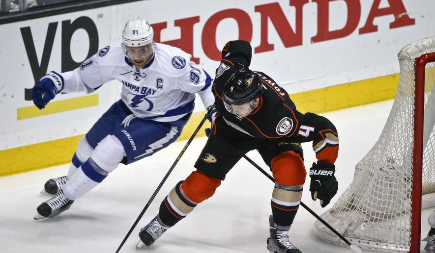 Anaheim Ducks defenseman Cam Fowler control the puck as he keeps Tampa Bay Lightning center Steven Stamkos at bay during the first period of a NHL hockey game Wednesday, Dec. 2, 2015, in Anaheim, Calif.  (AP Photo/Lenny Ignelzi)
