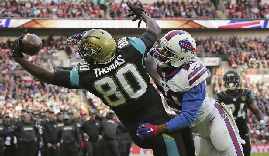 "FILE - In this Oct. 25, 2015, file photo, Jacksonville Jaguars tight end Julius Thomas (80) fails to catch the ball as Buffalo Bills free safety Corey Graham (20) defends during an NFL game in London. Inconsistent as the Bills have been, Graham sees no reason why they can't finally get on a roll to make a late-season playoff push. ""I believe in this team. I believe in what we're capable of doing,"" Graham said. ""We know what it takes. We know what's at stake. We know what we've got to do."" Beating the surging Houston Texans on Sunday would be a start for Buffalo (5-6), which has run out of room for error in mounting any realistic bid to end the NFL's longest active playoff drought at 15 seasons. (AP Photo/Tim Ireland, File)"