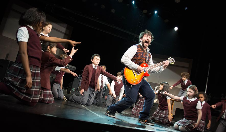 """In this image released by The O and M Company, Alex Brightman appears during a performance of """"School of Rock,"""" in New York. The actor, writer and comedian was hand-picked for the role by Andrew Lloyd Webber. (Timmy Blupe/ The O and M Co. via AP)"""