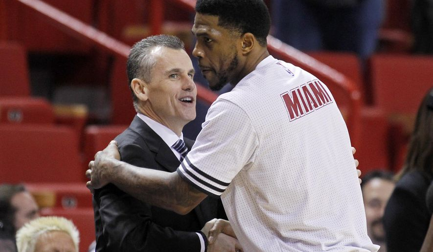 Oklahoma City Thunder head coach Billy Donovan greets Miami Heat forward Udonis Haslem (40), one of his former University of Florida players, before the teams met in an NBA basketball game, Thursday, Dec. 3, 2015, in Miami. (AP Photo/Joe Skipper)
