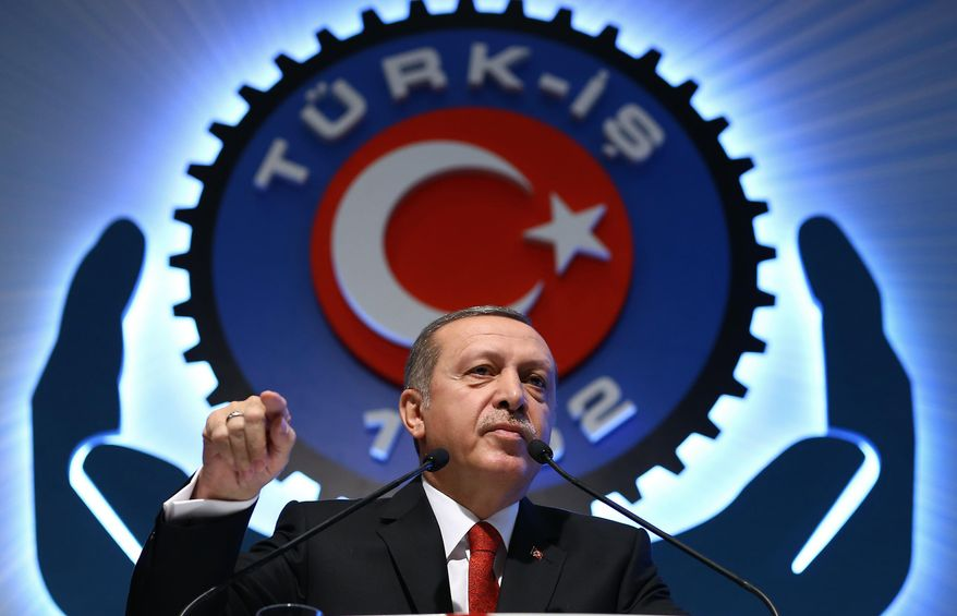 """Turkey's President Recep Tayyip Erdogan addresses a labor union meeting in Ankara, Turkey, Thursday, Dec. 3, 2015. Russia's President Vladimir Putin on Thursday hinted at more sanctions against Turkey and accused Turkey of a """"treacherous war crime"""" in downing a Russian jet at the border with Syria. Erdogan has hotly denied that his country was involved in oil trade with the Islamic State group , and has pledged to step down if Moscow proves its accusations. (Murat Cetinmuhurdar, Presidential Press Service, Pool via AP)"""