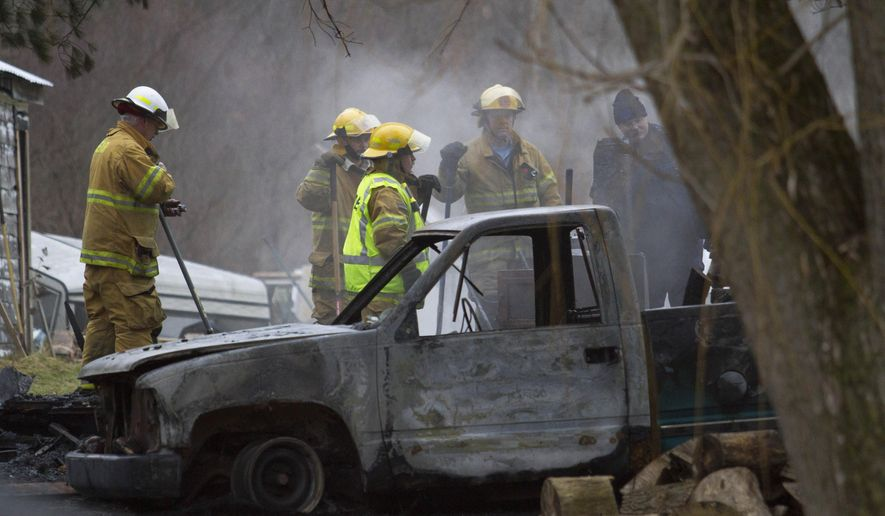 Vassar Fire Department and Michigan State Police respond to a house fire in Vassar Township, Mich., Tuesday, Dec. 1, 2015. The sheriff's department said the home was engulfed in flames and firefighters found a body inside. (David C. Bristow/The Saginaw News via AP)