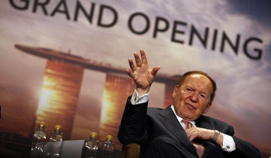 In this Feb. 17, 2011 photo, Las Vegas Sands Corp. Chief Executive Sheldon Adelson addresses the media during the grand opening ceremony of the Marina Bay Sands in Singapore. Casino billionaire Adelson spent more on the 2012 federal elections than any other donor, putting up about $90 million of his family's money. His willingness to make a huge political investment helps explain why his signature group, the Republican Jewish Coalition, has attracted all of the major GOP presidential candidates to its forum Thursday, Dec. 3, 2015 in Washington - even though the man himself won't be among the 700 people in attendance. (AP Photo/Wong Maye-E, File)