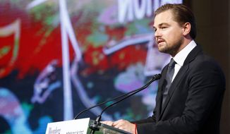 Leonardo DiCaprio adresses to the audience during a meeting with Mayors to push for local actions to fight climate change at Paris city Hall on the margins of the COP21, as part of the COP21, United Nations Climate Change Conference, in Paris, Friday, Dec. 4, 2015.  (AP Photo/Francois Mori)