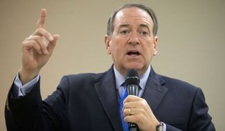 """Republican presidential candidate Mike Huckabee rails at the """"Washington-to-Wall-Street axis of power."""" (Associated Press/File)"""