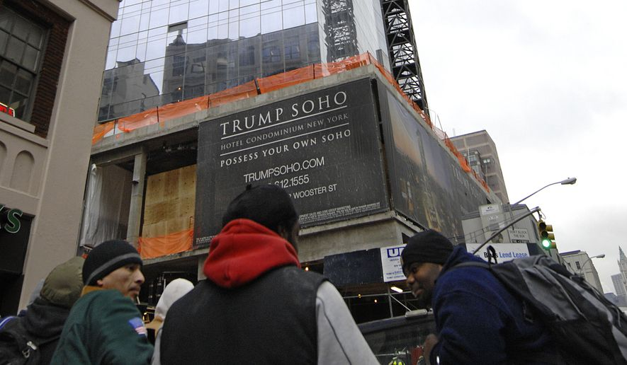 In this Jan. 14, 2008, file photo, construction workers gather across from the Trump Soho hotel-condominium where they were working in New York. Donald Trump tapped a man to be a senior business adviser to his real-estate empire even after the man's past involvement in a major mafia-linked stock fraud scheme became public. (AP Photo/ Louis Lanzano, File)