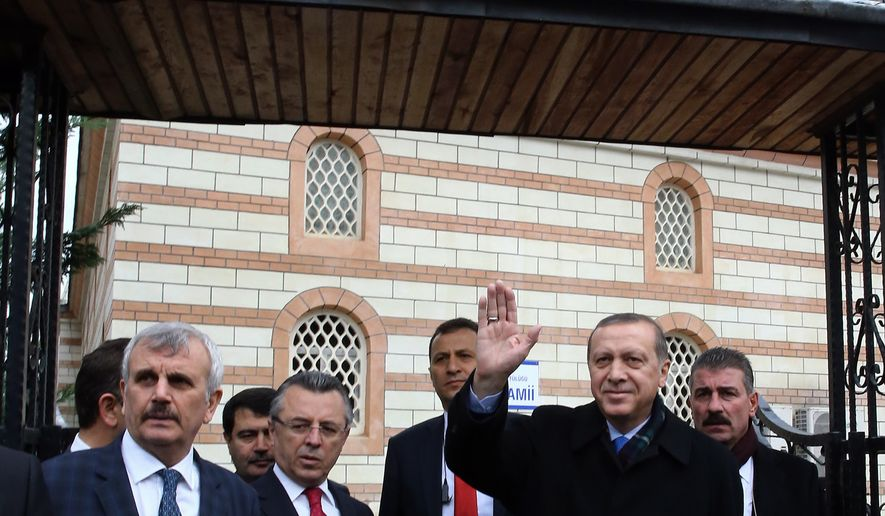 "Turkey's President Recep Tayyip Erdogan waves to supporters after Friday prayers in Istanbul, Turkey, Friday, Dec. 4, 2015. Russia's President Vladimir Putin on Thursday hinted at more sanctions against Turkey and accused Turkey of a ""treacherous war crime"" in downing a Russian jet at the border with Syria. ""Allah must have punished Turkey's ruling clique by depriving it of sense and reason,"" Putin said. Erdogan has hotly denied that his country was involved in oil trade with the IS, and has pledged to step down if Moscow proves its accusations.(AP Photo/Murat Cetinmuhurdar, Presidential Press Service, Pool)"
