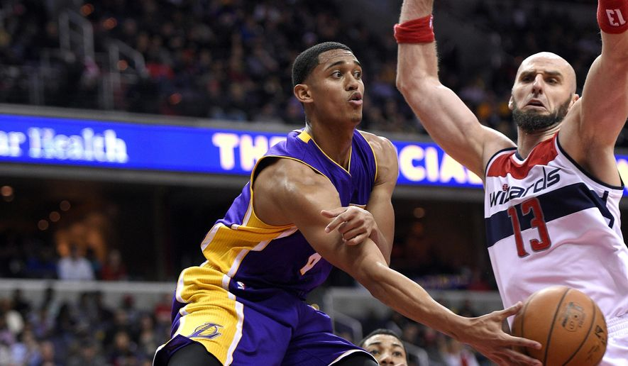 Los Angeles Lakers guard Jordan Clarkson (6) passes the ball against Washington Wizards center Marcin Gortat (13), of Poland, during the first half of an NBA basketball game, Wednesday, Dec. 2, 2015, in Washington. (AP Photo/Nick Wass)