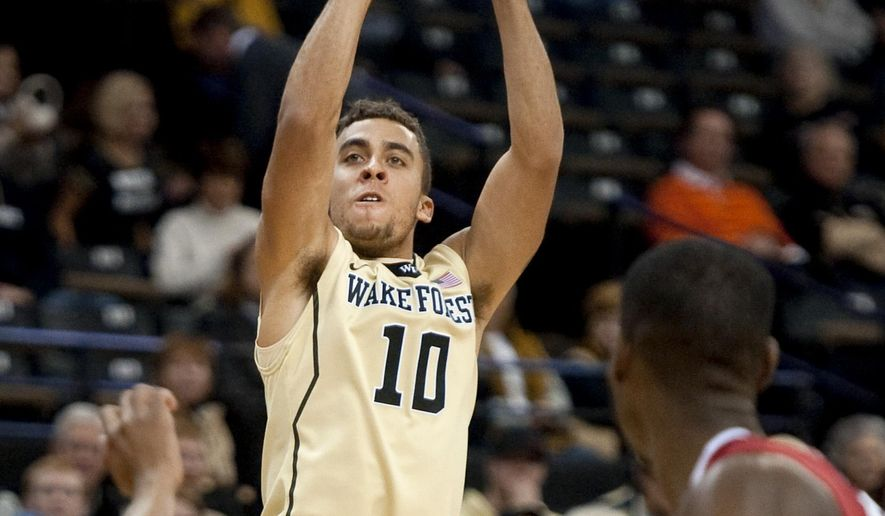 Wake Forest's Mitchell Wilbekin shoots a 3-pointer against Arkansas during an NCAA college basketball game Friday, Dec. 4, 2015, in Winston-Salem, N.C. (Lauren CarrollWinston-Salem Journal via AP)