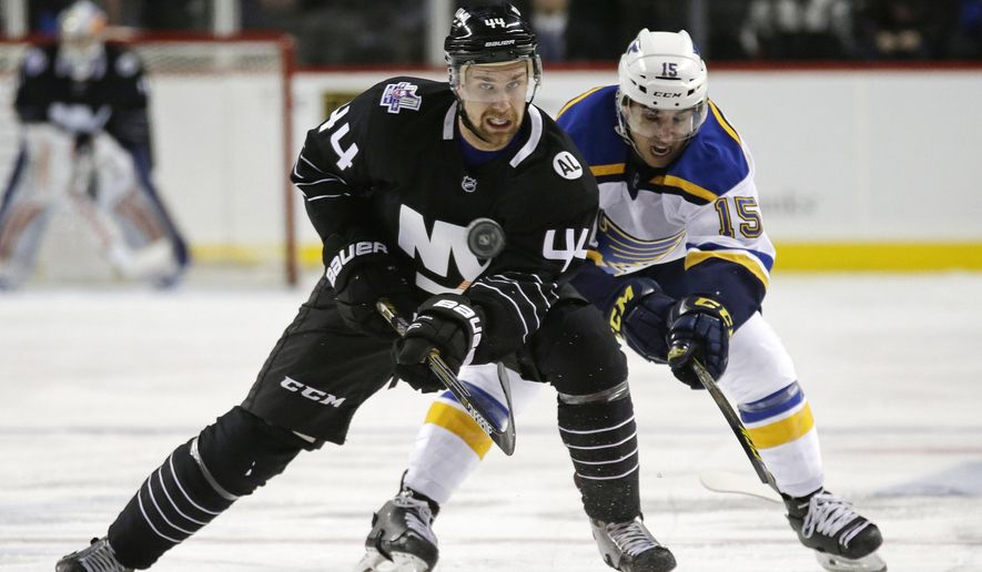 New York Islanders defenseman Calvin de Haan (44) passes the puck away from St. Louis Blues center Robby Fabbri (15) during the second period of an NHL hockey game in New York, Friday, Dec. 4, 2015. (AP Photo/Adam Hunger)