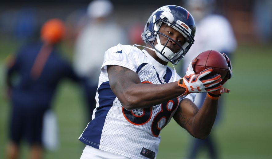 FILE - In this Wednesday, Nov. 4, 2015, file photo, Denver Broncos wide receiver Demaryius Thomas pulls in pass during an NFL practice session at the team's headquarters in Englewood, Colo. The one offensive player for the Broncos who hasn't benefited from Brock Osweiler's ascendence to starting quarterback is Demaryius Thomas. The Pro Bowl receiver caught just one of 13 passes thrown his way against New England, the worst performance of his career. (AP Photo/David Zalubowski, File)