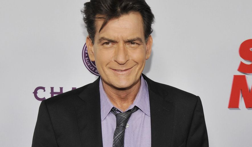 """FILE - In this April 11, 2013, file photo, Charlie Sheen, a cast member in """"Scary Movie V,"""" poses at the Los Angeles premiere of the film at the Cinerama Dome in Los Angeles. Scottine Ross, a porn star who performed under the name Brett Rossi, sued the actor on Thursday, Dec. 3, 2015, for assault, battery and intentional infliction of emotional distress claims. Her lawsuit states she and Sheen had sex five times before the actor told her he was HIV positive. (Photo by Chris Pizzello/Invision/AP, File)"""