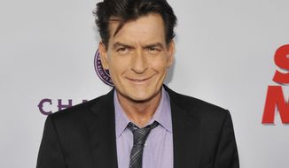 "FILE - In this April 11, 2013, file photo, Charlie Sheen, a cast member in ""Scary Movie V,"" poses at the Los Angeles premiere of the film at the Cinerama Dome in Los Angeles. Scottine Ross, a porn star who performed under the name Brett Rossi, sued the actor on Thursday, Dec. 3, 2015, for assault, battery and intentional infliction of emotional distress claims. Her lawsuit states she and Sheen had sex five times before the actor told her he was HIV positive. (Photo by Chris Pizzello/Invision/AP, File)"