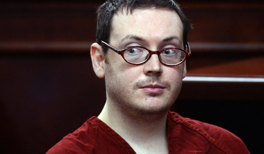 FILE - In this Aug. 24, 2015, file photo, James Holmes appears in court for the sentencing phase in his trial at Arapahoe County District Court in Centennial, Colo. Holmes has been ordered to pay about $955,000 in restitution to the victims of his 2012 movie theater shooting, money that will never likely be paid by the imprisoned mass killer. (RJ Sangosti/The Denver Post via AP, Pool, File)