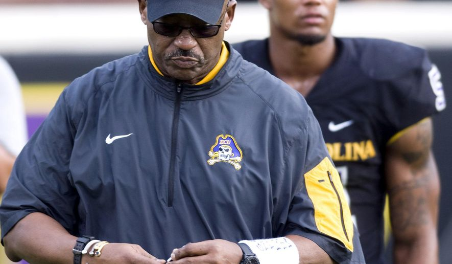 FILE - In this Nov. 28, 2015, file photo, East Carolina head coach Ruffin McNeill ends the season with a loss to Cincinnati, at Dowdy-Ficklen Stadium in Greenville N.C. East Carolina fired coach Ruffin McNeill after six seasons, athletic director Jeff Compher said Friday, Dec. 4, 2015. (Scott Davis/The Daily Reflector via AP, File) MANDATORY CREDIT