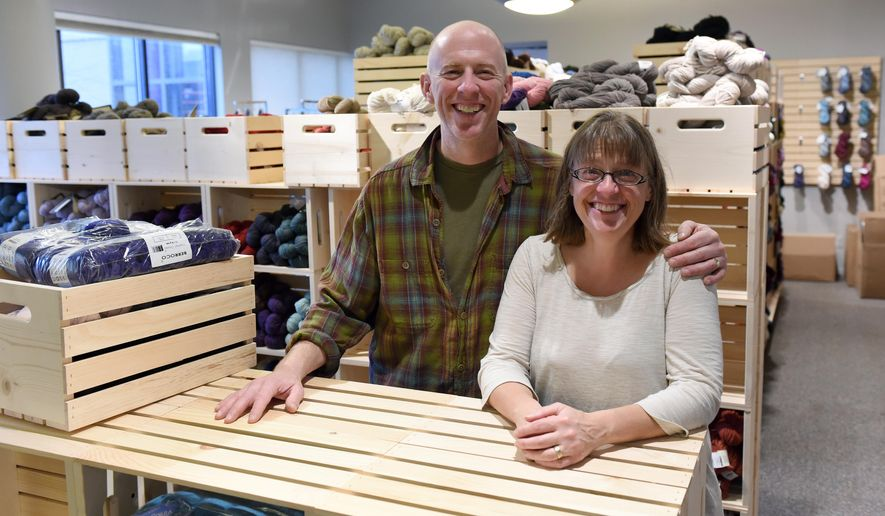 In this photo taken on Wednesday, Nov. 18, 2015, Spun owners Carol and Peter Sickman-Garner pose for a photo in the yarn shop at Kerrytown Market in Ann Arbor, Mich, (Melanie Maxwell /The Ann Arbor News via AP) LOCAL TELEVISION OUT; LOCAL INTERNET OUT; MANDATORY CREDIT