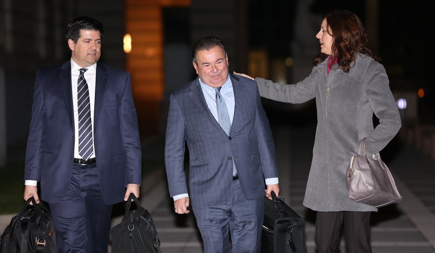 Joe Ferriero, center, former chairman of the Bergen County Democratic Organization, leaves the Newark Federal Court House after his sentencing on Friday, Dec. 4, 2015 evening in Newark, NJ.  At left is attorney Michael Baldassare and pictured right is attorney Jennifer Mara.  (Jim Alcorn/The Record of Bergen County via AP)