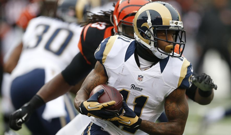 ADVANCE FOR SUNDAY, DEC. 6 AND THEREAFTER- FILE- In this Nov. 29, 2015 file photo, St. Louis Rams wide receiver Tavon Austin (11) runs for 60 yards in the first half of an NFL football game against the Cincinnati Bengals, in Cincinnati. With increasing frequency, NFL teams are throwing screen passes, to running backs, yes, but also to tight ends or wide receivers , in an effort to get easy gains and, occasionally, break long ones. There are about 1 1/2 more completed screens per game this season than just five years ago, according to STATS. (AP Photo/Gary Landers, File)
