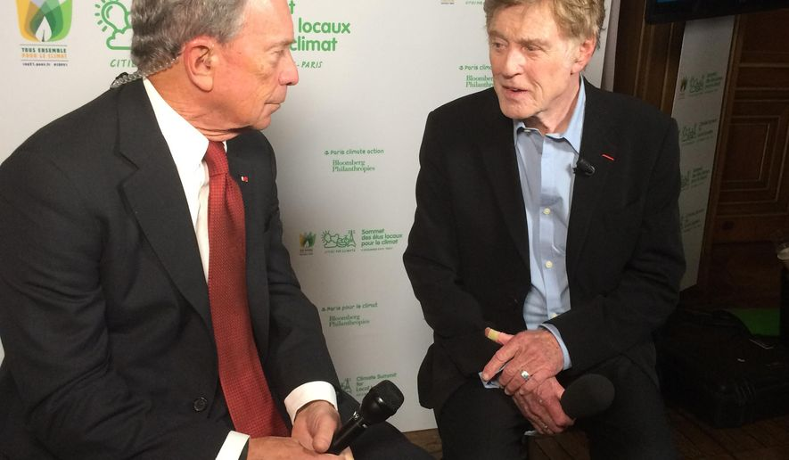 UN special envoy for cities and climate and former New York city mayor, Michael Bloomberg, left, talks with US actor and climate campaigner Robert Redford prior to an interview at the Paris city Hall, France, as part of the COP21, the United Nations Climate Change conference,  Friday, Dec. 4, 2015. (AP Photo/Catherine Gaschka)