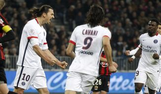 PSG's Zlatan Ibrahimovic, second from left, reacts with his teammates, after scoring the second goal against Nice, during the French League One soccer match between Nice and Paris Saint Germain, Friday, Dec. 4, 2015,  in Nice stadium, southeastern France. (AP Photo/Lionel Cironneau)