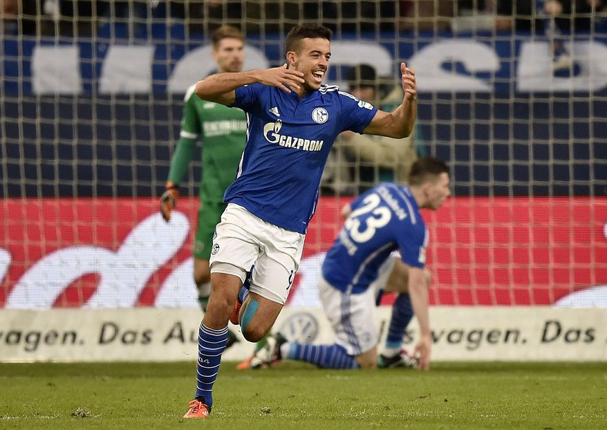 Schalke's Franco di Santo celebrates after scoring his side's third goal during the German Bundesliga soccer match between FC Schalke 04 and Hannover 96 in Gelsenkirchen, Germany, Friday, Dec. 4, 2015. (AP Photo/Martin Meissner)