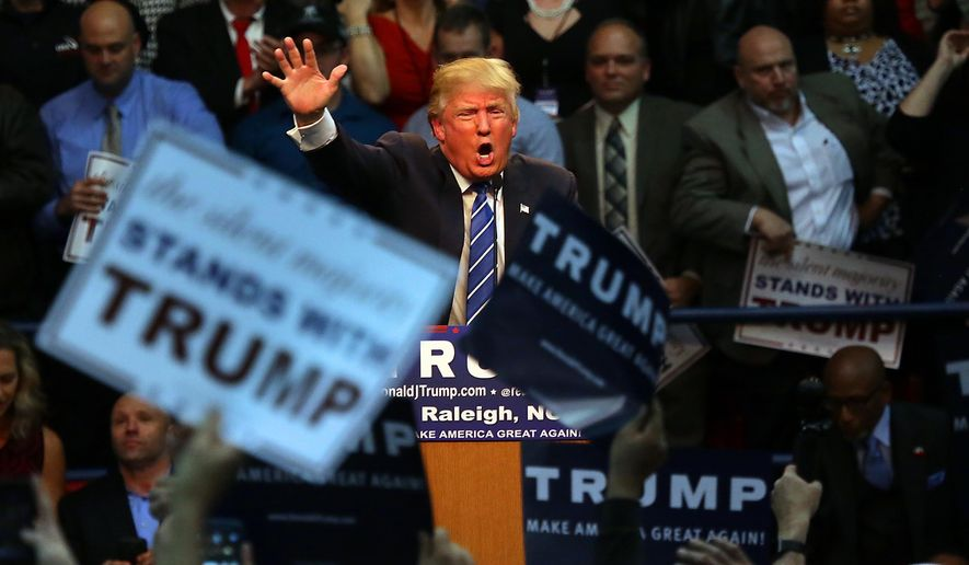 Republican presidential candidate Donald Trump energizes the crowd during a campaign rally at Dorton Arena in Raleigh, N.C., Friday, Dec. 4, 2015. (AP Photo/Ted Richardson) ** FILE **