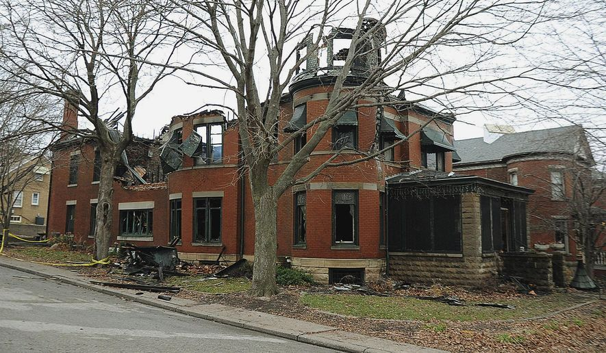 The Huttig mansion damaged after Tuesday's fire waits to be demolished in Muscatine, Iowa, Thursday, Dec. 3, 2015. The historic mansion built in 1892 has been demolished after it sustained severe damage from the fire. (Beth Van Zandt/Muscatine Journal via AP) MANDATORY CREDIT