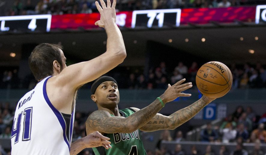 Boston Celtics' Isaiah Thomas looks to shoot past Sacramento Kings' Kosta Koufos (41) during the second half of an NBA basketball game in Mexico City, Thursday, Dec. 3, 2015. (AP Photo/Rebecca Blackwell)