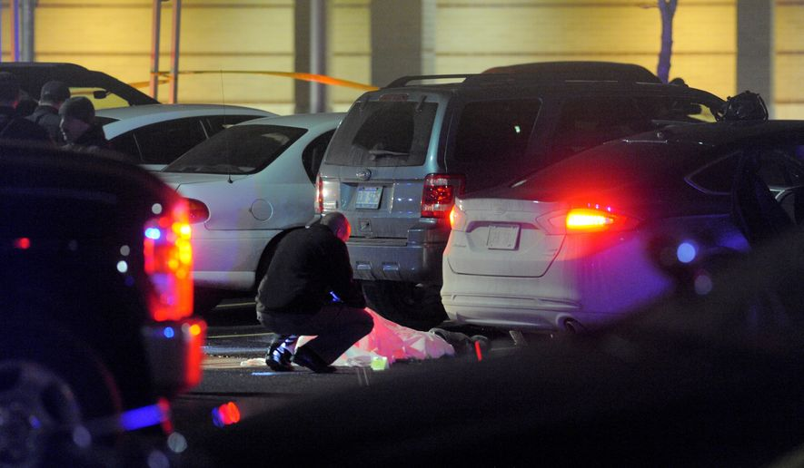 In this photo taken on Thursday, Dec. 3, 2015, Taylor police investigate a shooting, outside the Taylor Sportsplex in Taylor, Mich.  (Steve Perez/Detroit News via AP)  DETROIT FREE PRESS OUT; HUFFINGTON POST OUT; MANDATORY CREDIT
