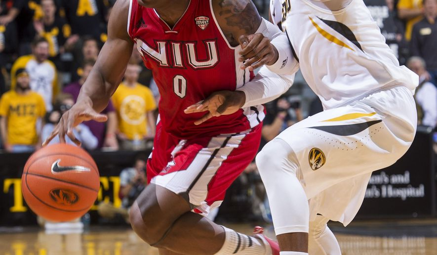 Northern Illinois's Marshawn Wilson, left, is fouled by Missouri's Terrence Phillips, right, as he dribbles during the second half of an NCAA college basketball game Friday, Dec. 4, 2015, in Columbia, Mo. Missouri won the game 78-71. (AP Photo/L.G. Patterson)