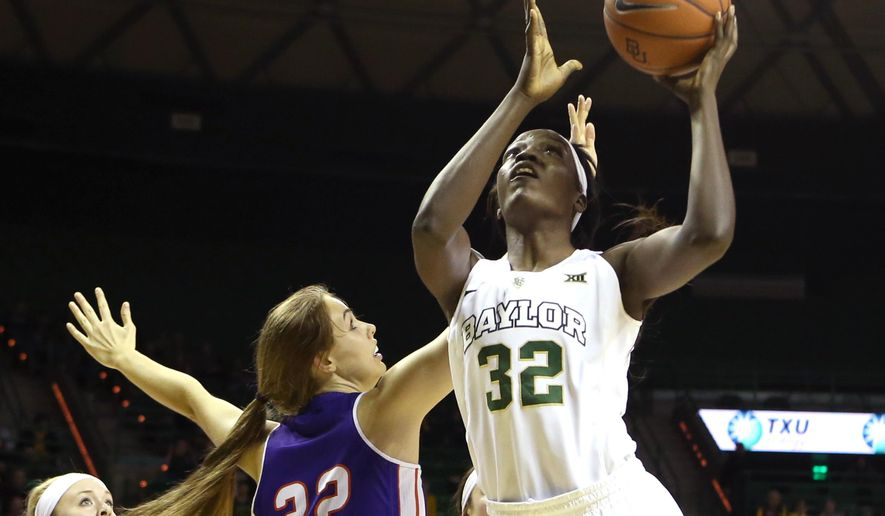 Baylor forward/center Beatrice Mompremier (32) shoots past Northwestern State forward/center Cheyenne Brown (32) in the second half of an NCAA college basketball game, Friday, Dec. 4, 2015, in Waco, Texas. (AP Photo/Jerry Larson)