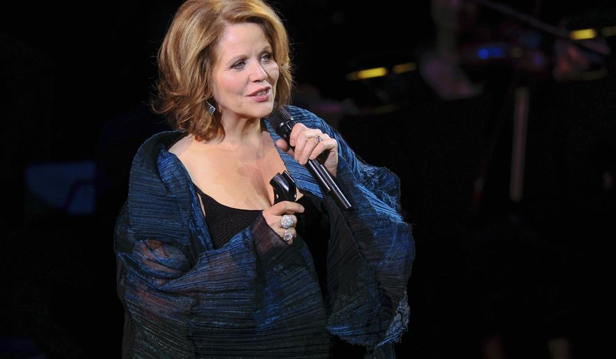 """FILE - In this March 2, 2015 file photo, opera singer Renee Fleming performs at """"An Evening of SeriousFun Celebrating the Legacy of Paul Newman"""", hosted by the SeriousFun Children's Network at Avery Fisher Hall in New York. The Lyric Opera of Chicago's Monday, Dec. 7, 2015 world premiere of """"Bel Canto"""" is unique. Fleming commissioned the work based on the popular novel and, rare for opera, it tells the story of a modern event. (Photo by Evan Agostini/Invision/AP)"""