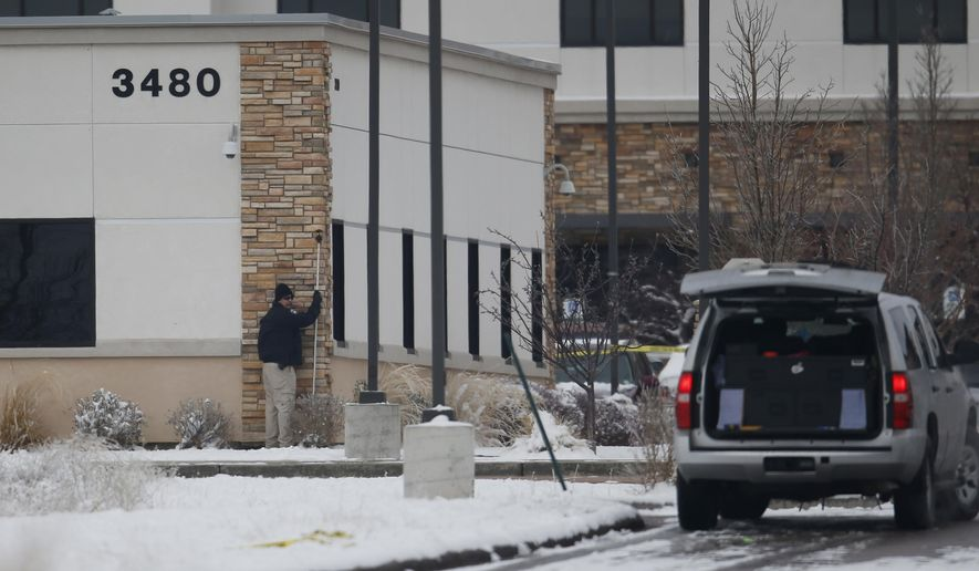 FILE --In this Sunday, Nov. 29, 2015, file photograph, a police investigators holds up measure while gathering evidence from the Friday shooting at a Planned Parenthood clinic in northwest Colorado Springs, Colo. In the wake of the deaadly shooting last Friday in Colorado Springs, clinics nationwide are redoubling security efforts. (AP Photo/David Zalubowski, file)