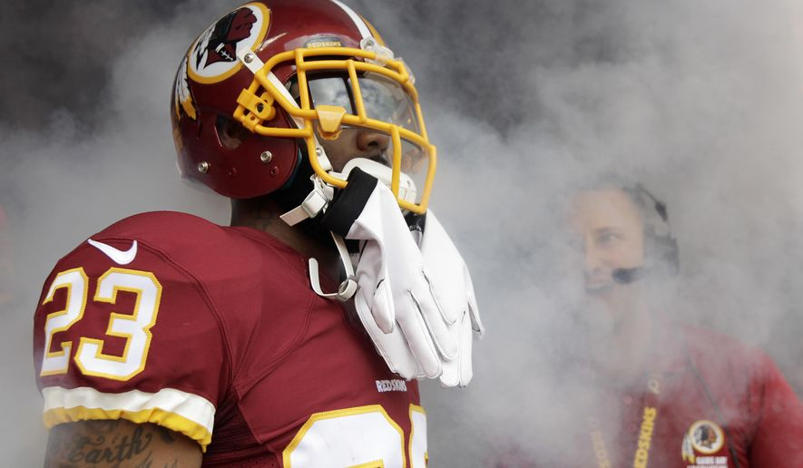 In this photo taken Sept. 20, 2015,  Washington Redskins cornerback DeAngelo Hall (23) waits in the tunnel for his introduction before an NFL football game against the St. Louis Rams in Landover, Md.  At the outset of training camp for the Washington Redskins, DeAngelo Hall was a cornerback, just as he had been throughout his NFL career. And now? He's a starting safety. Back when the first practices of the preseason were unfolding, Quinton Dunbar was a rookie wide receiver. These days, he's a cornerback who's playing key minutes. (AP Photo/Mark Tenally)