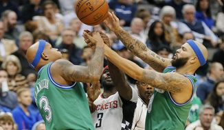 Houston Rockets guard Ty Lawson, center, vies with Dallas Mavericks forward Charlie Villanueva, left, and guard Deron Williams for the ball during the first half of an NBA basketball game Friday, Dec. 4, 2015, in Dallas. (AP Photo/Brandon Wade)