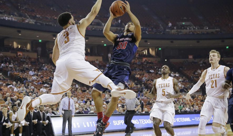 Samford guard Christen Cunningham (00) shoots over Texas guard Javan Felix (3) during the first half of an NCAA college basketball game Friday, Dec. 4, 2015, in Austin, Texas. (AP Photo/Eric Gay)