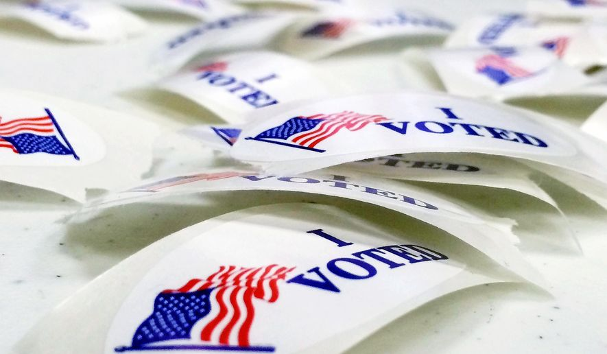 """I Voted"" stickers lie on a table in the Norton Shores Library in Norton Shores, Mich. (Associated Press)"