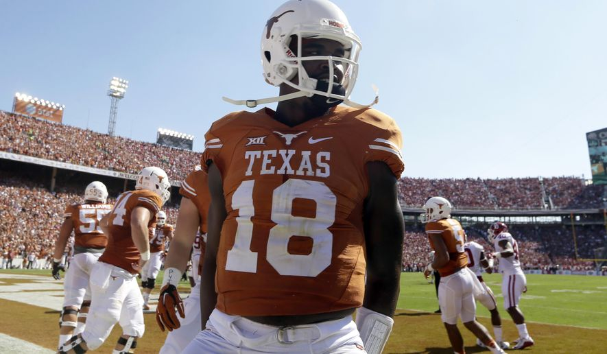 FILE - In this Oct. 10, 2015, file photo, Texas quarterback Tyrone Swoopes (18) celebrates his touchdown during an NCAA college football game against Oklahoma in Dallas.  Texas freshman starting quarterback Jerrod Heard is sidelined for Saturday's game against Baylor after a concussion. Swoopes, replaced as the starter after the first game, is back in that role.  (AP Photo/LM Otero, File)