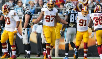 Washington Redskins defensive end Jason Hatcher (97) reacts after making a tackle against the Carolina Panthers during an NFL game at Bank of America Stadium in Charlotte, N.C. on Sunday, Nov. 22, 2015. (Chris Keane/AP Images for Panini)