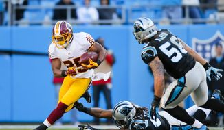 Washington Redskins running back Chris Thompson (25) runs the ball against the Carolina Panthers during an NFL game at Bank of America Stadium in Charlotte, N.C. on Sunday, Nov. 22, 2015. (Chris Keane/AP Images for Panini)
