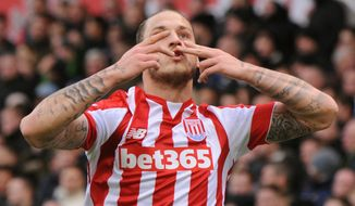 Stoke's Marko Arnautovic celebrates after scoring his second goal against Manchester City during the English Premier League soccer match between Stoke City and Manchester City at the Britannia Stadium, Stoke on Trent, England, Saturday, Dec. 5, 2015. (AP Photo/Rui Vieira)