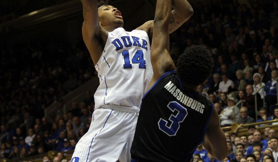 Duke's Brandon Ingram (14) shoots over Buffalo's CJ Massinburg during an NCAA college basketball game in Durham, N.C., Saturday, Dec. 5, 2015.  (AP Photo/Ted Richardson)