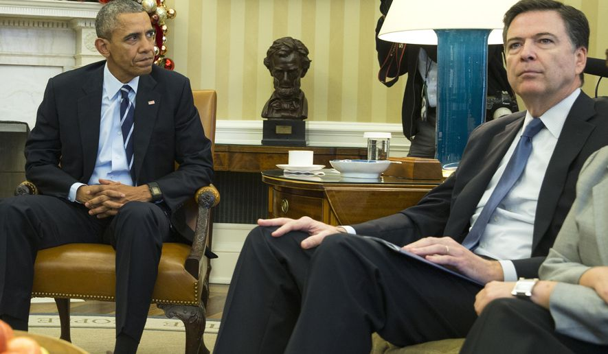 In this Dec. 3, 20156 photo, President Barack Obama sits with FBI director James Comey in the Oval Office of the White House in Washington, before making a statement on the mass shooting in San Bernandino, Calif.  The U.S. government's ability to review and analyze five years' worth of telephone records for the married couple blamed in the deadly shootings in California lapsed when the National Security Agency's controversial mass surveillance program was formally shut down, four days before the deadly California shootings.  Under a court order, those historical calling records at the NSA are now off-limits to agents running the FBI terrorism investigation even with a warrant.  (AP Photo/Evan Vucci)