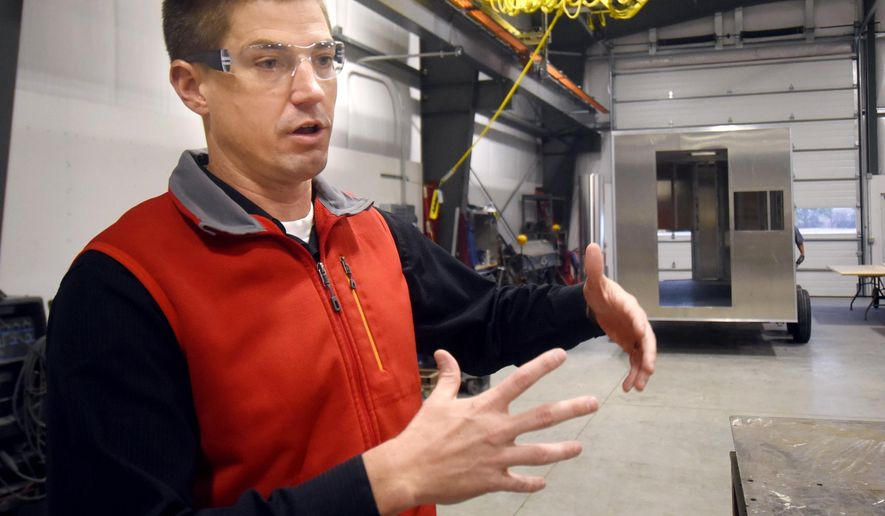 ADVANCE FOR THE WEEKEND OF DEC. 5-6 AND THEREAFTER - In a Nov. 17, 2015 photo, Will Schmautz, president and CEO of Nomad Global Communication Solutions explains the how the assembly process of their vehicles works at their location near the Glacier International Airport in Columbia Falls, Mt. Schmautz, his brother and two friends founded Nomad Technologies in 2002. (Tommy Martino/The Missoulian via AP) MANDATORY CREDIT