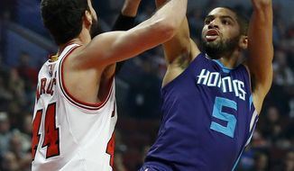 Charlotte Hornets guard Nicolas Batum (5) shoots over Chicago Bulls forward Nikola Mirotic (44) during the first half of an NBA basketball game in Chicago, Saturday, Dec. 5, 2015. (AP Photo/Andrew A. Nelles)