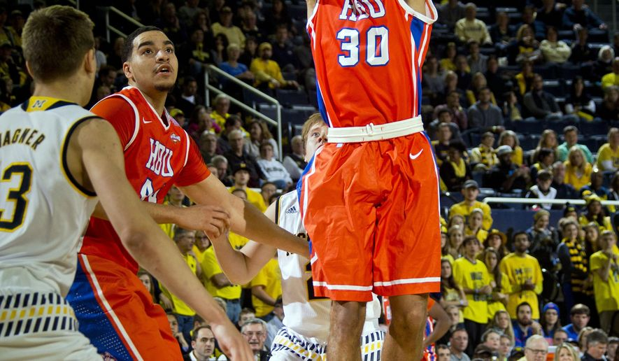 Houston Baptist guard Jourdan Stickler (30) takes a jump shot in the first half of an NCAA college basketball game against Michigan at Crisler Center in Ann Arbor, Mich., Saturday, Dec. 5, 2015. (AP Photo/Tony Ding)