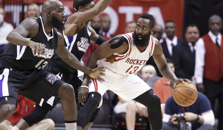 Houston Rockets' James Harden, right, is double-teamed by Sacramento Kings Quincy Acy, left, and Rajon Rondo during the first half of an NBA basketball game Saturday, Dec. 5, 2015, in Houston. (AP Photo/Pat Sullivan)