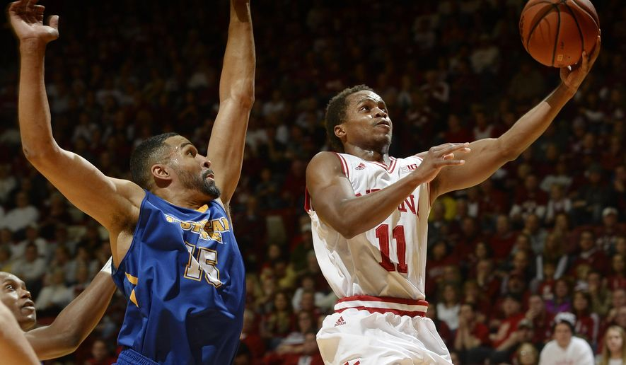Indiana guard Yogi Ferrell, right, drives around Morehead State forward DeJuan Marrero, left, for a bucket during an NCAA college basketball game in Bloomington, Ind., Saturday, Dec. 5, 2015. (Chris Howell/The Herald-Times via AP)