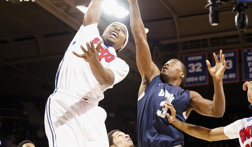 New Hampshire forward Jacoby Armstrong (3) shoots over SMU guard Sterling Brown, left, and guard Nic Moore (11) during the first half of an NCAA basketball game, Saturday, Dec. 5, 2015, in Dallas. (AP Photo/Jim Cowsert)